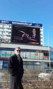 Darius in front of a billboard in Szczecin